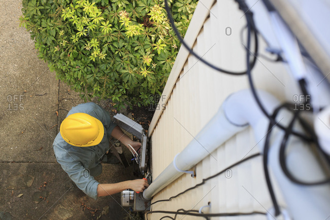 Man installing cable box