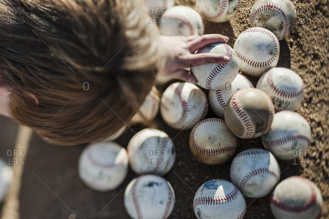 Boy choosing baseball on field