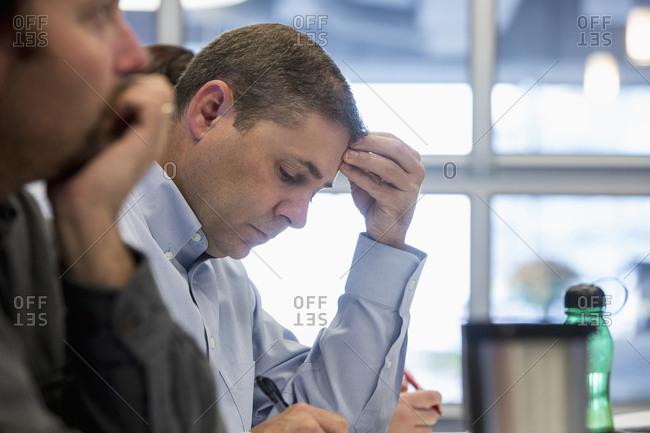 People sitting in office meeting