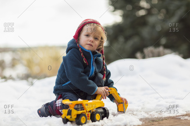 Boy playing with truck in snow