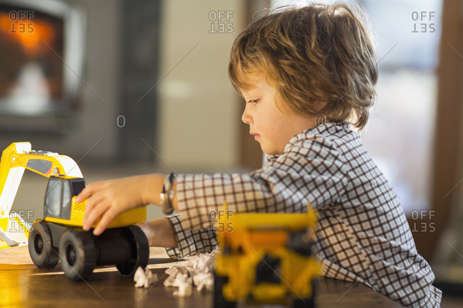 Boy playing with trucks