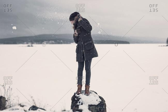 Teenage girl dodging snowballs