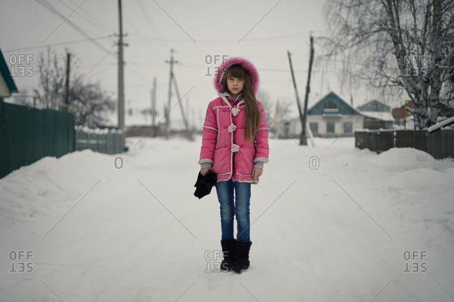 Girl standing on snowy street
