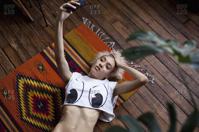 Sexy woman taking a selfie