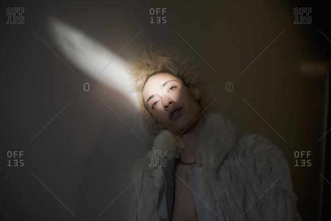 Woman in fur coat in sunlight