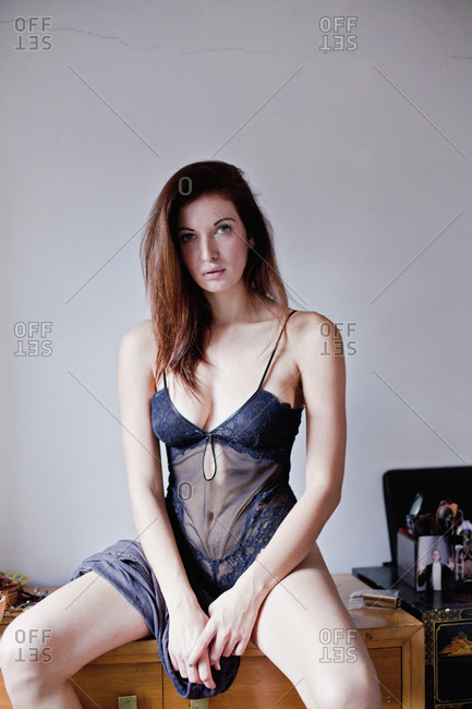 Woman in negligee on nightstand