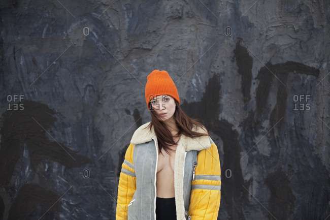 Sexy woman in jacket by rock