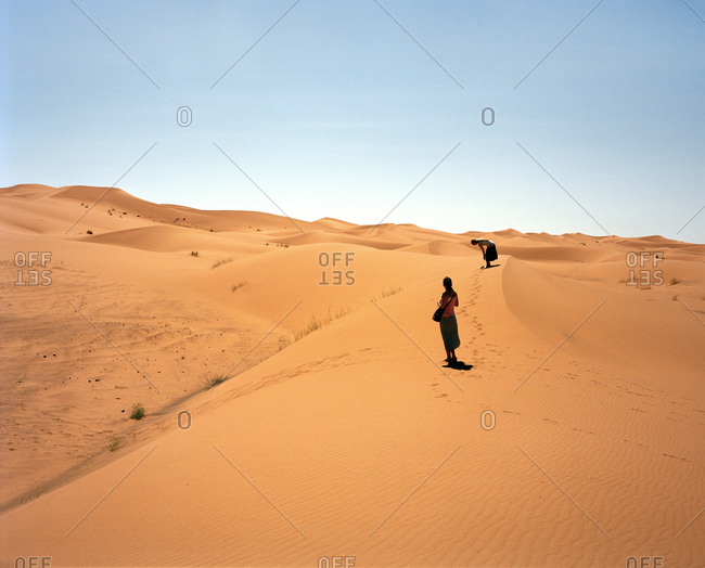 Two women standing in the Sahara Desert in Morocco