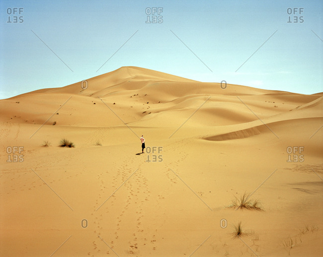 Woman standing in the Sahara Desert in Morocco
