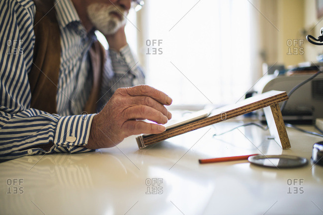 Hand of man using tablet