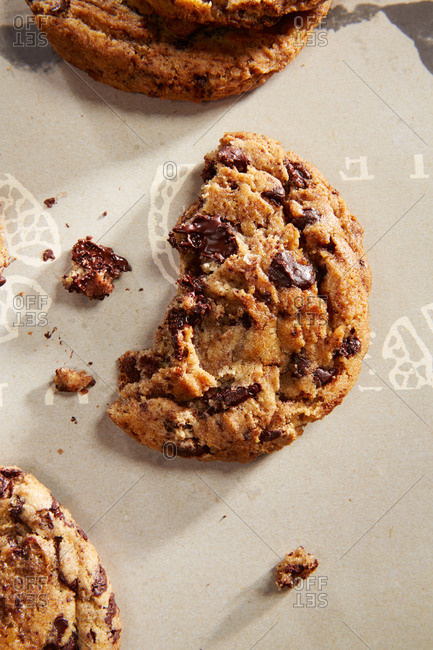 Close-up of chocolate chip cookies on patterned paper