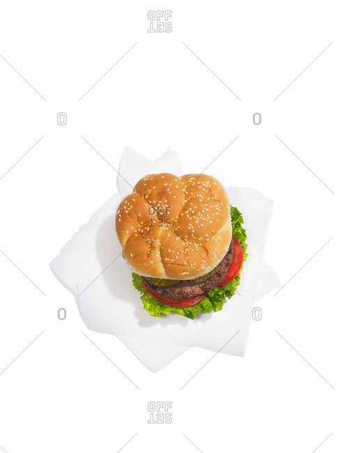 Overhead view of a hamburger on a white background