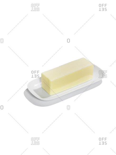 A stick of butter on a white background