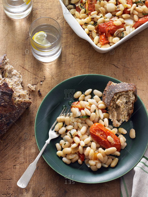 A bowl of Tuscan beans serviced with crusty bread