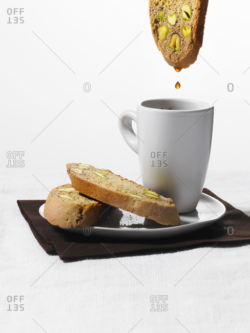 Biscotti and coffee on a white background