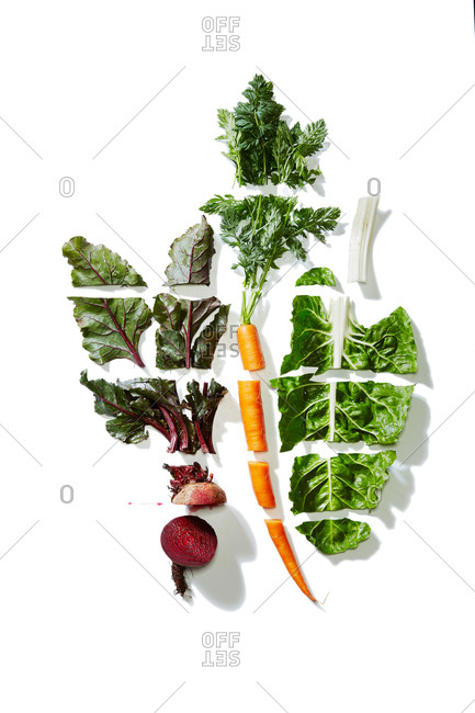 Overhead view of sliced vegetables on a white background