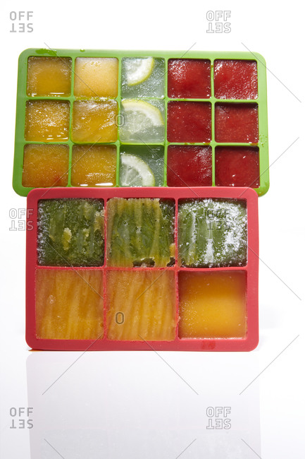 Overhead view of colorful ice cubes in ice cube trays