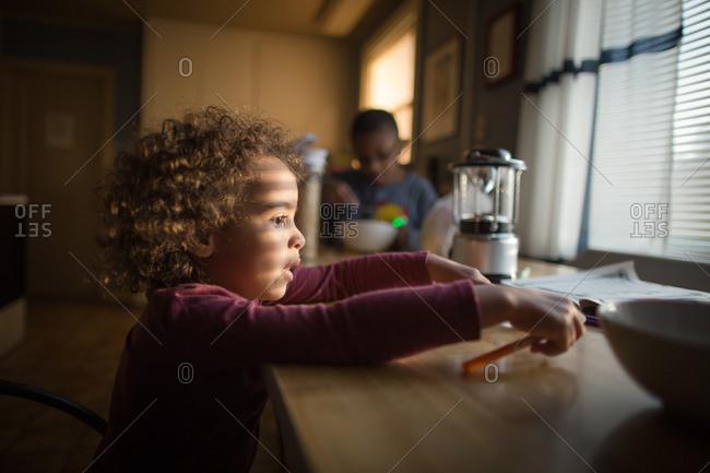 Siblings at the breakfast table