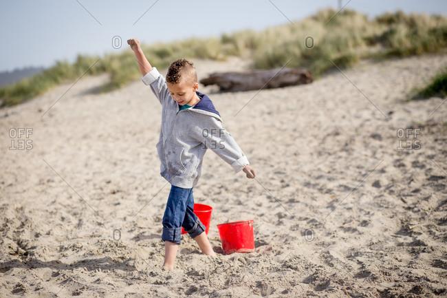 Boy walking on a sandy beach