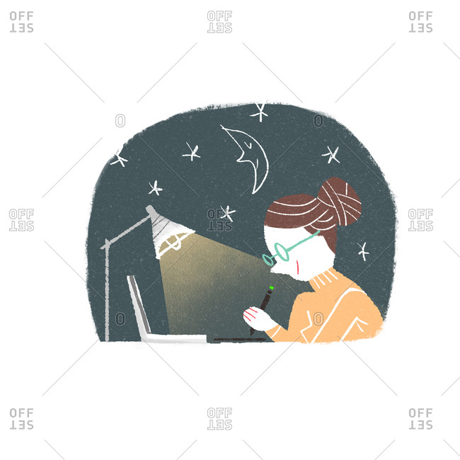 Woman working by her desk at night