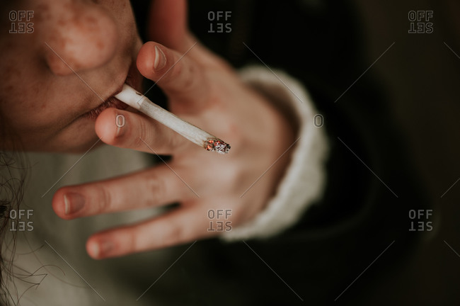 Close-up of woman smoking a cigarette