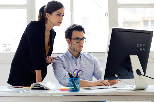 Coworkers at a computer