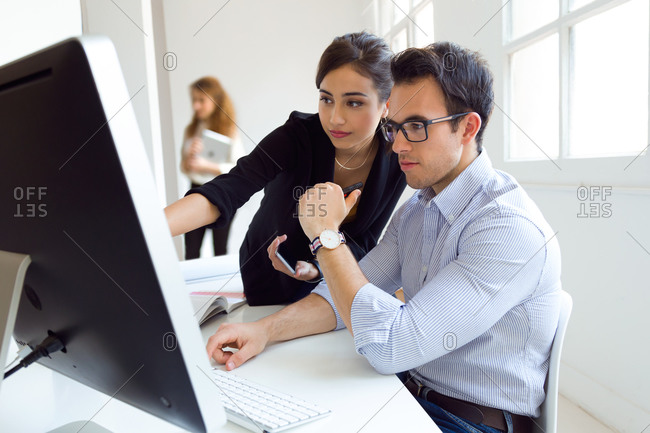 Colleagues at desktop computer