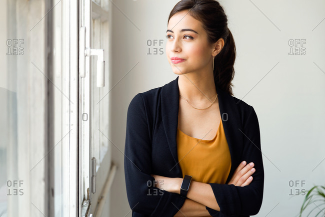 Woman in office at window