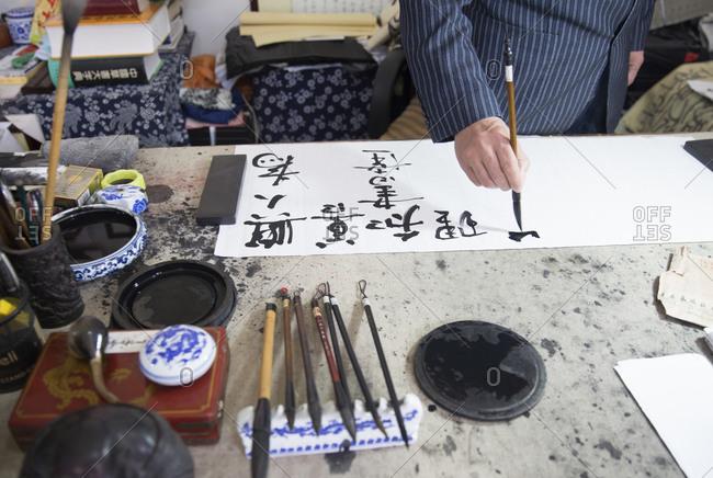 Calligrapher working in Shanghai, China