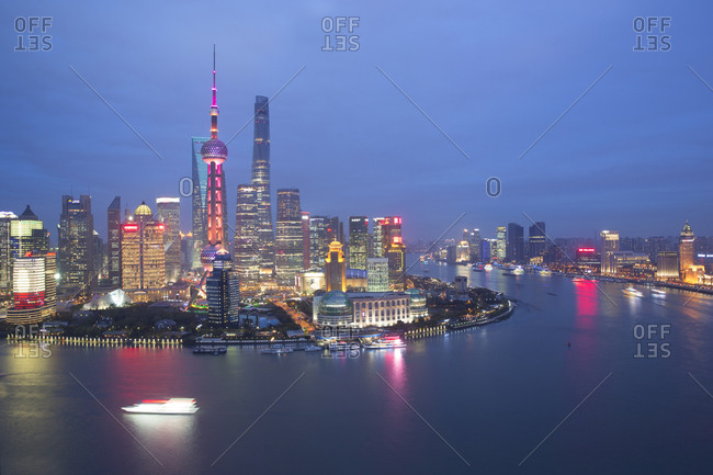 An aerial view at dusk of the Pudong business district in Shanghai, China
