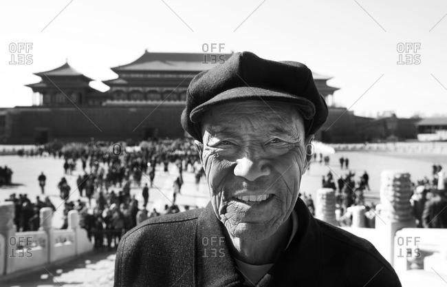Beijing, China - March 22, 2016: Man standing near the Forbidden City, Beijing, China
