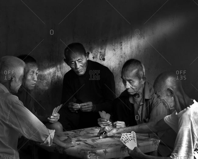 Guilin, China - October 16, 2012: Chinese men playing cards in Guilin, China