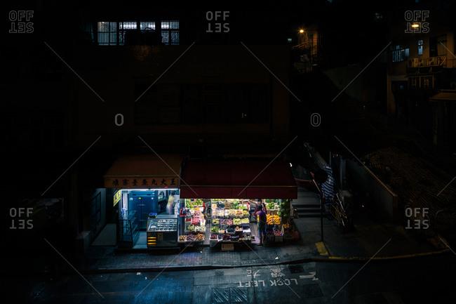 April 14, 2016: Fruit market on a dark street in Hong Kong