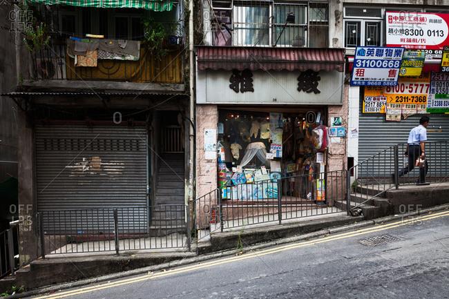 September 24, 2013: Man walking up a slanted street in Hong Kong