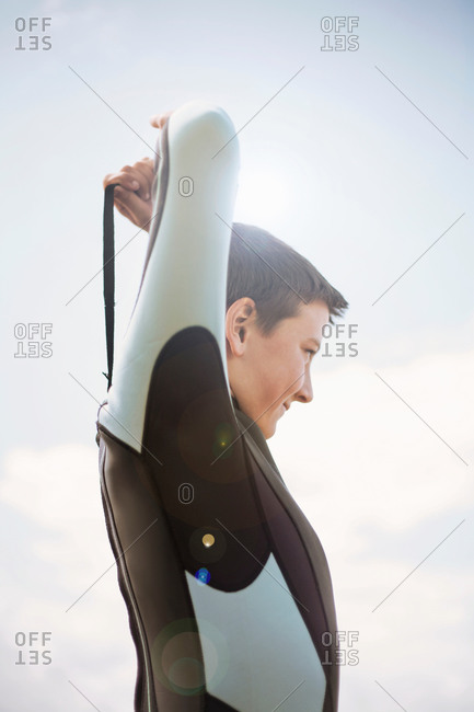Boy zipping up wetsuit