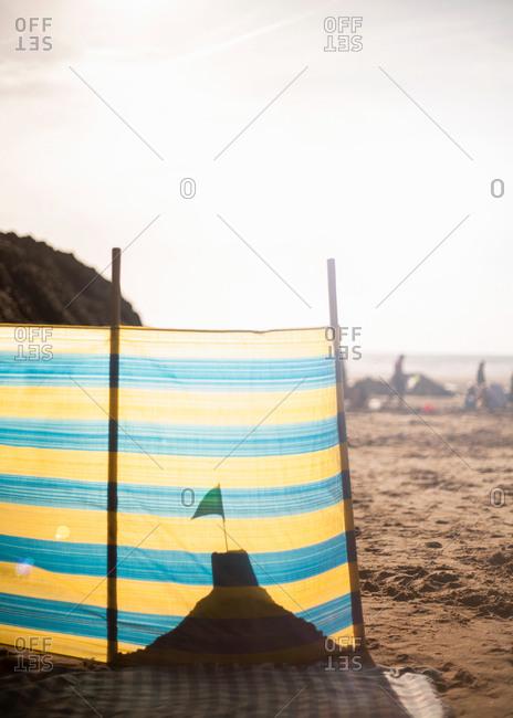 Sandcastle behind windbreak on beach