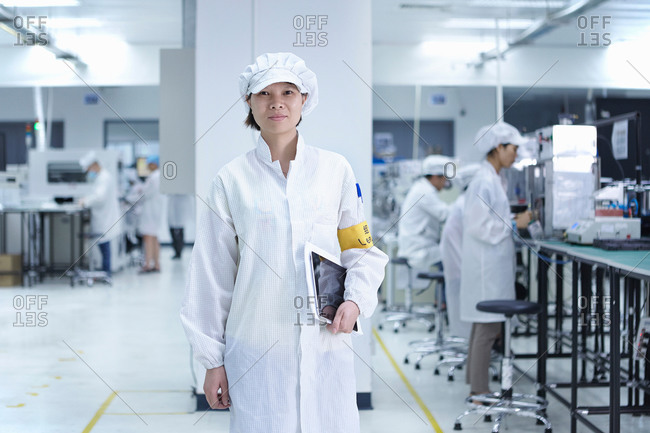 Portrait of worker in factory that specializes in creating functional circuits on flexible surfaces