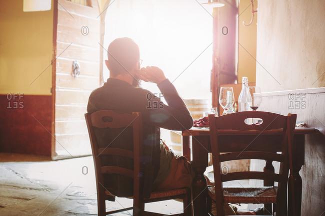 Man taking break at trattoria, Cortona, Italy