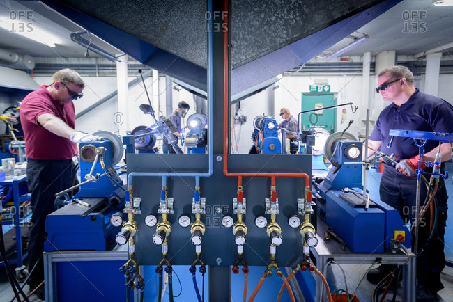 Workers in industrial glass factory