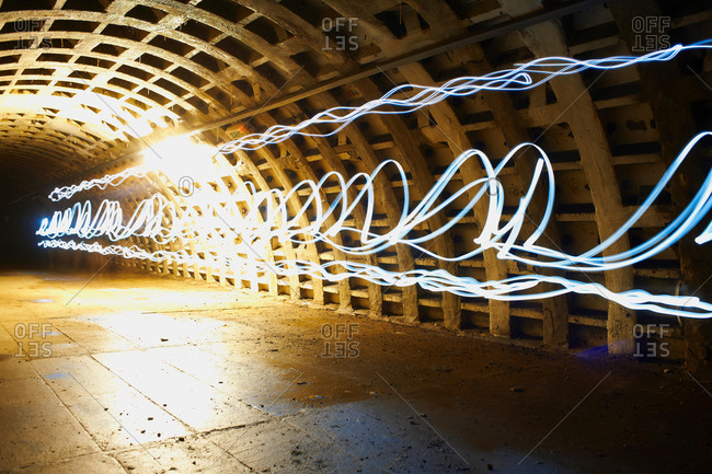 Light trails through grid tunnel