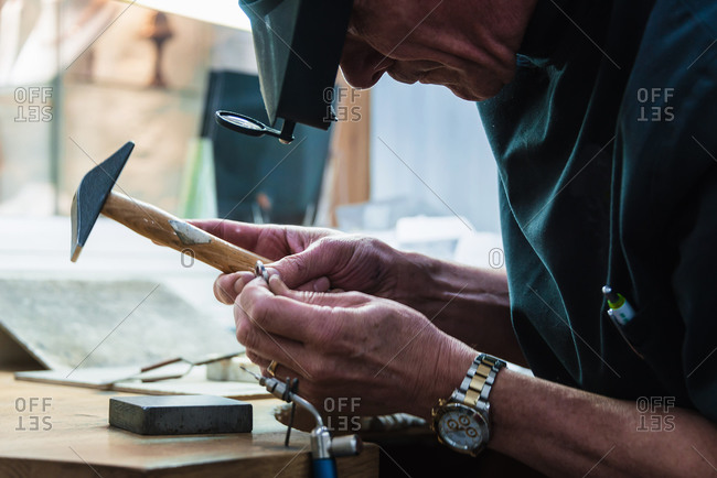 Jewelry craftsman examining platinum ring