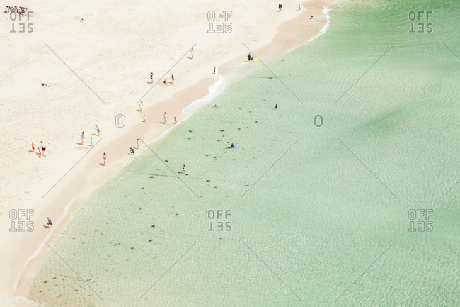 Aerial view of vacationers on beach, Porthcurno, Cornwall, UK