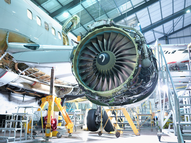 Detail of jet engine in aircraft maintenance factory
