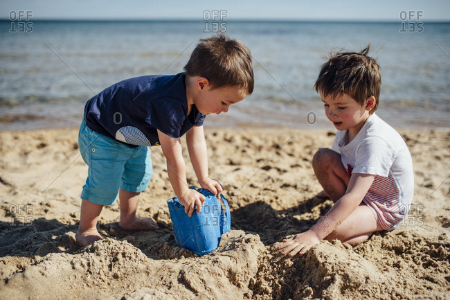 Two boys playing the sand