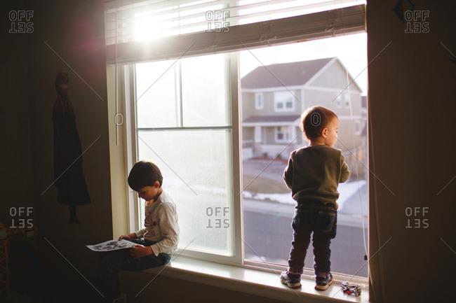 Boys in window of suburban home