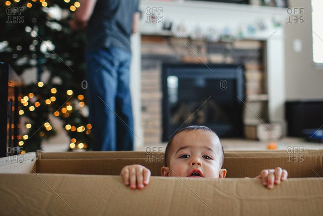 Boy in box at Christmas time