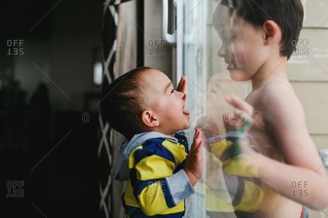 Boys on opposite sides of door