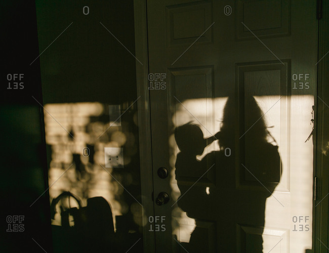 Woman and child in shadow