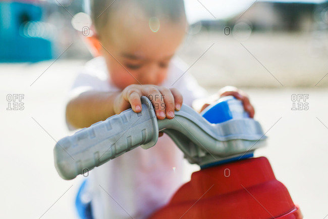 Boy with scooter toy