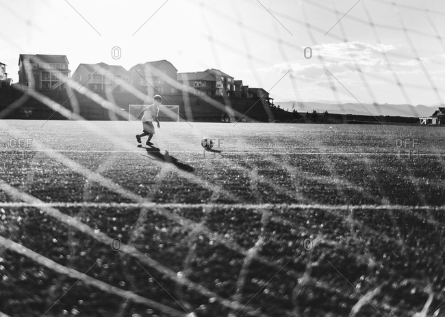 Boy running in soccer field